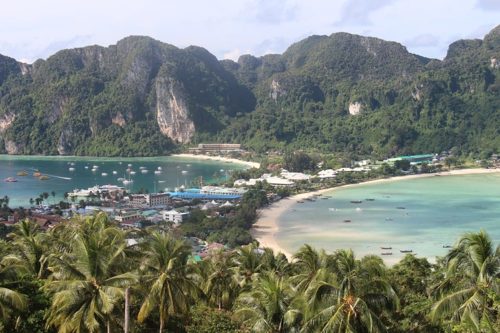 A view over Koh Phi Phi and its best hotels, a skinny piece of land in the middle that widens into two cliff-topped pieces of land.