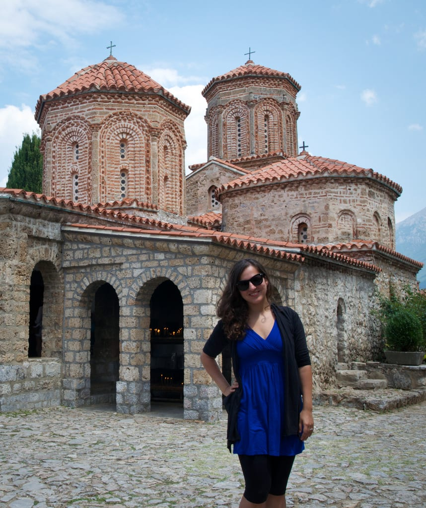 Kate poses at the church in Sveti Naum, North Macedonia