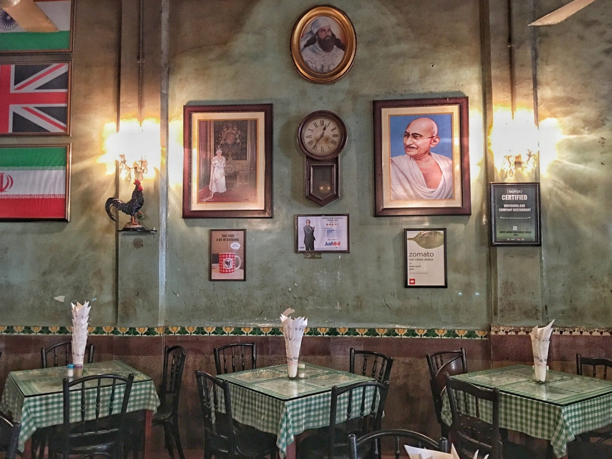A cafe in Mumbai filled with pictures from India and Britain.