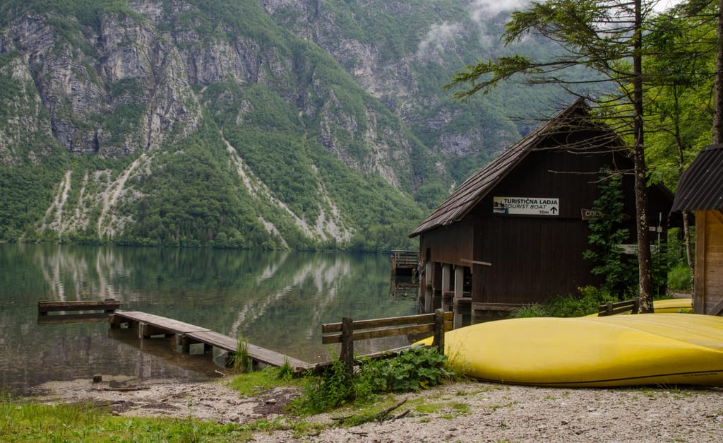 A yellow kayak and cabin in Lake Bohinj Slovenia