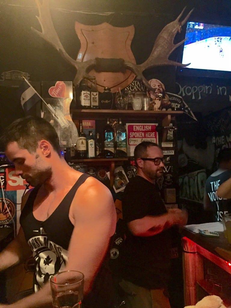 Bartenders pouring drinks in the Loose Moose, San Juan Del Sur