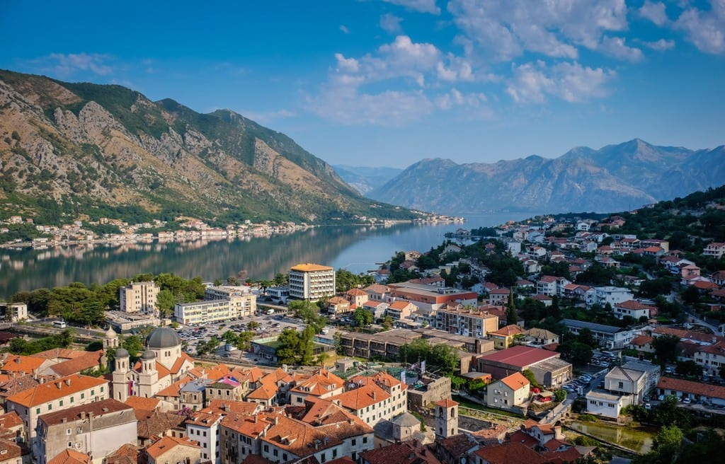 Morning at the Bay of Kotor, Montenegro, orange roofs and a bright blue sky