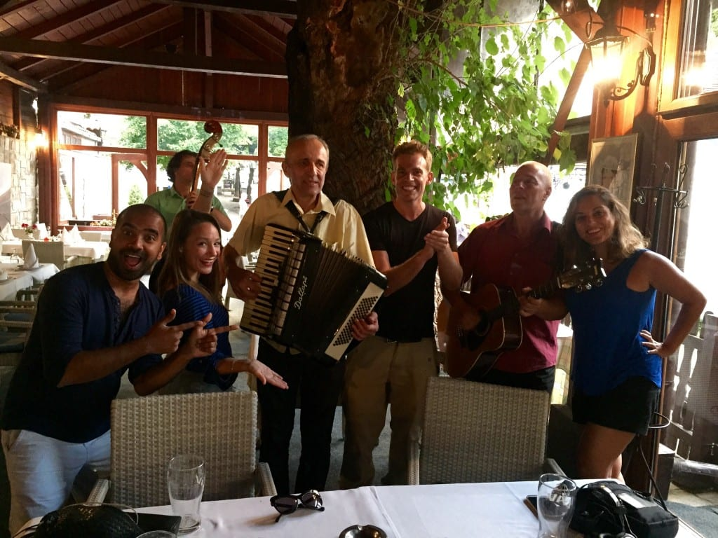 Kate, Kash, Leah, and Rob with a band of accordion players in Belgrade