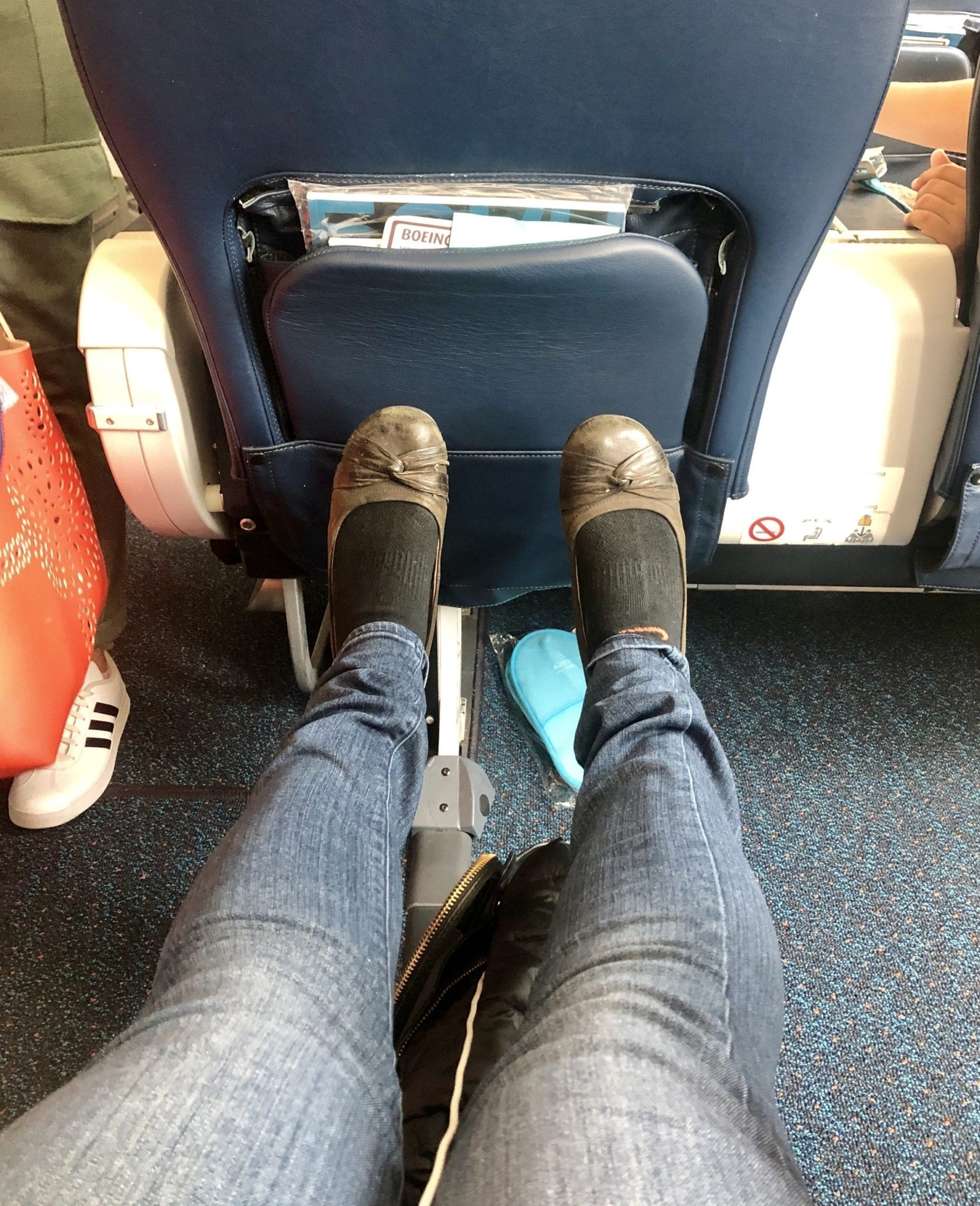 Kate stretches out her legs in her seat on Azerbaijan Airlines -- she's five foot four and her feet can't reach the seat in front of her.