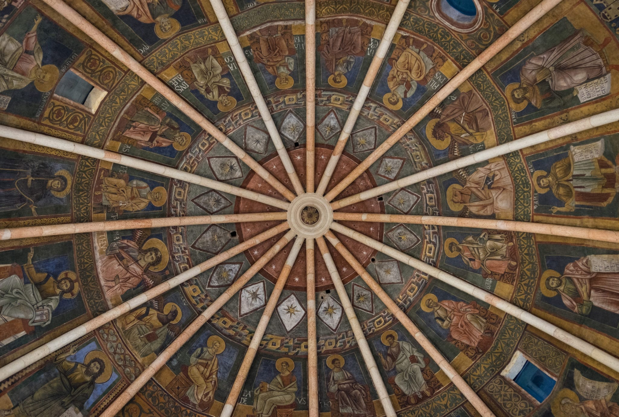 Parma's Baptistery ceiling -- planks leading to the center like a starburst, each segment covered in intricate frescoes.