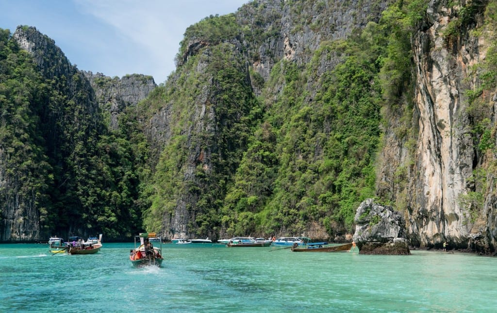 Boats in the turquoise water on Phi Phi Island, Thailand.