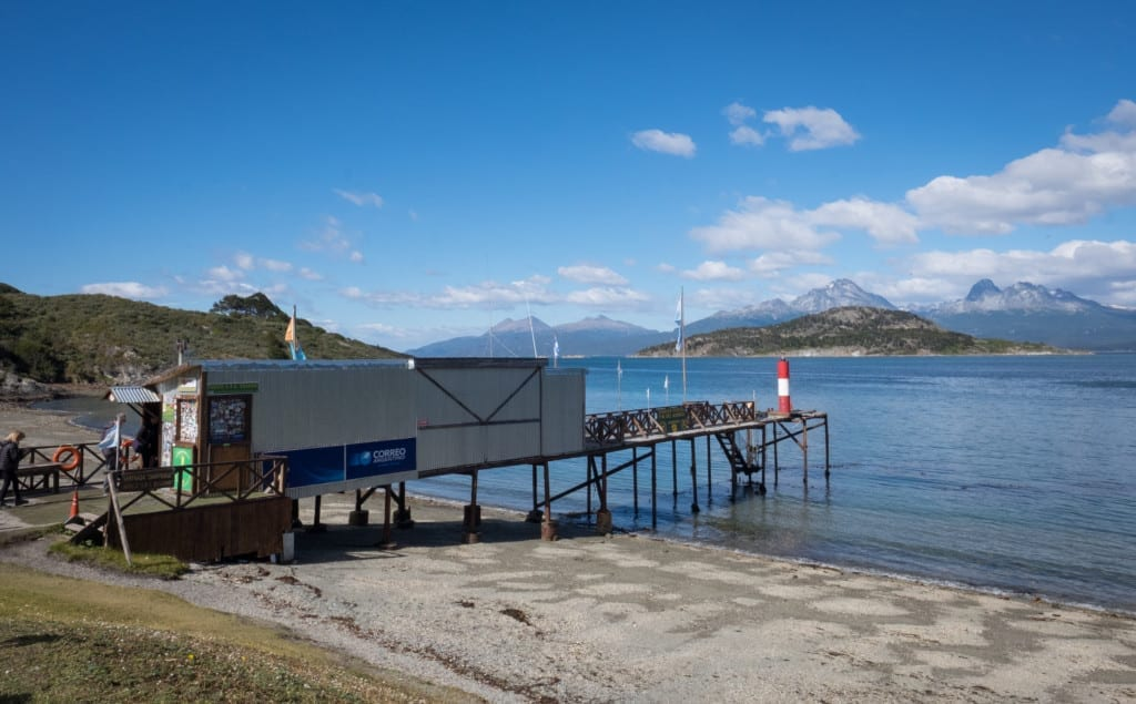 A post office built out of a shipping container leading out into a lake.