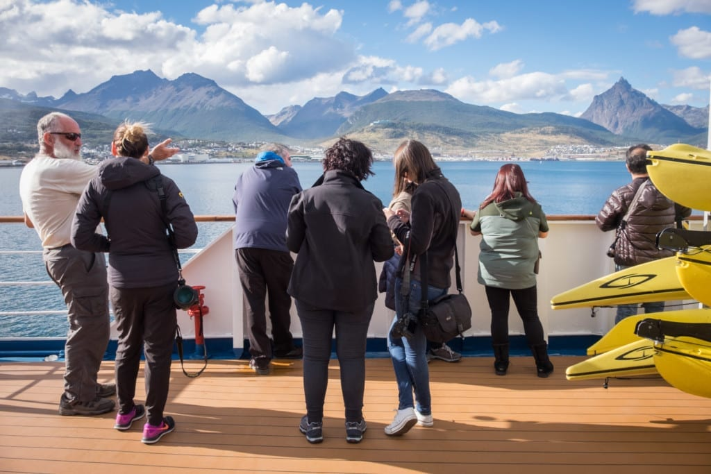 Guests on an Antarctica cruise watching the Ushuaia scenery go by.