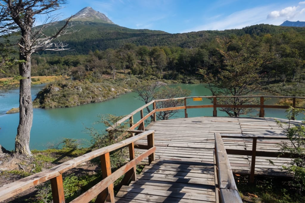 A deck in front of a bright turquoise lake in Patagonia.