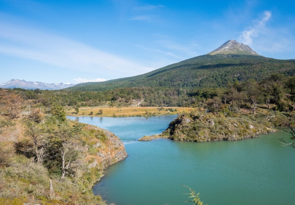 Mountains of Tierra del Fuego National Park in front of a still turquoise lake.