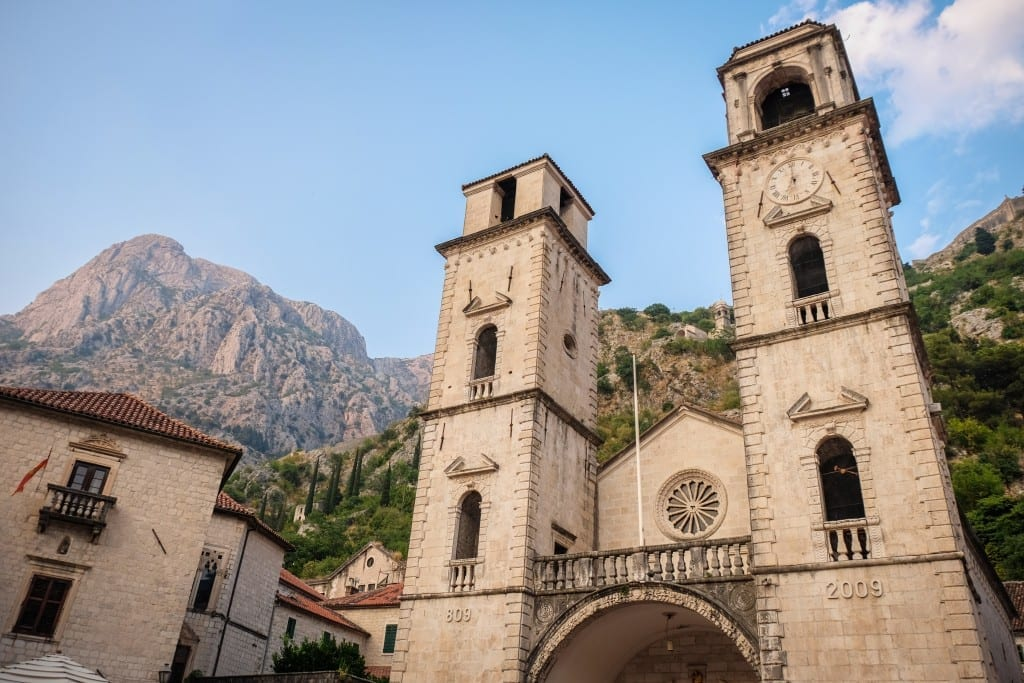 A church in Kotor set against the mountains.