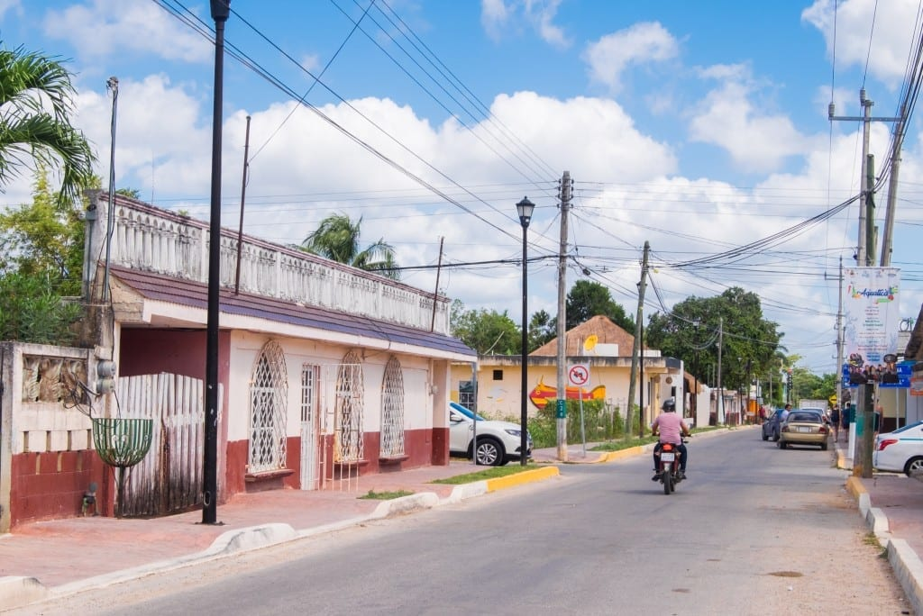 A motorcycle driving down the street in Bacalar, Mexico