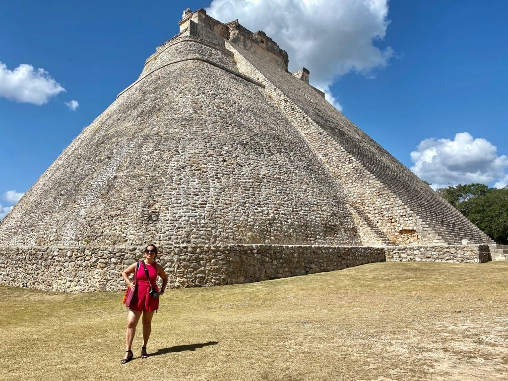Kate stands in front of a huge Mayan pyramid at Uxmal.