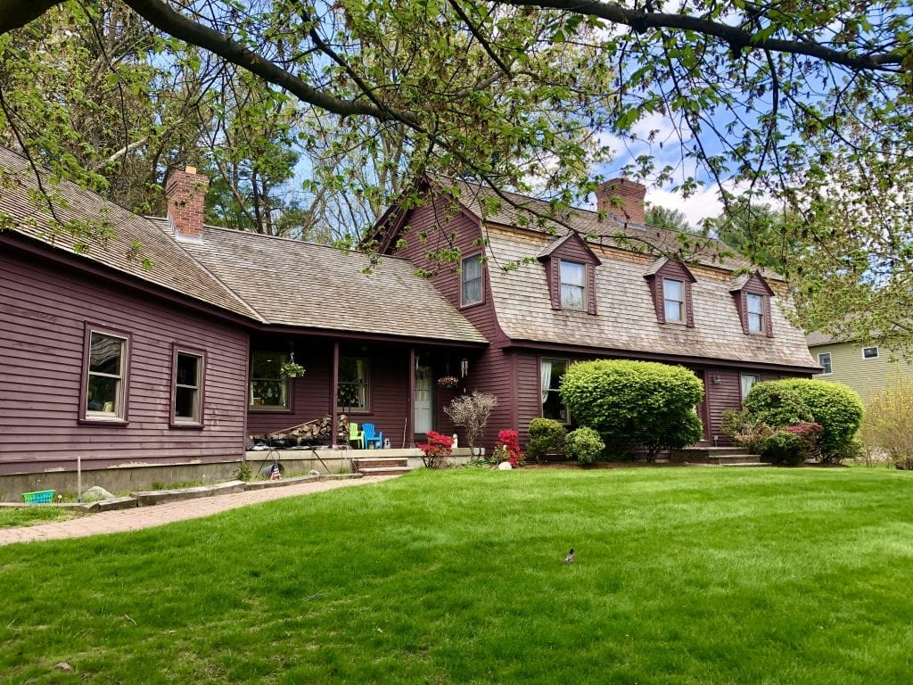 An eggplant-purple old-fashioned colonial home in Reading that looks a bit like a barn.
