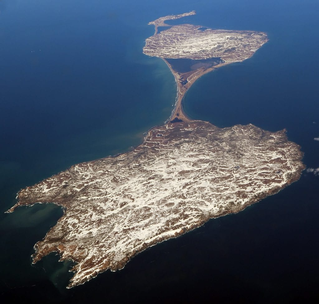 Miquelon Island as viewed from the air, shaped liked an hourglass in the ocean.