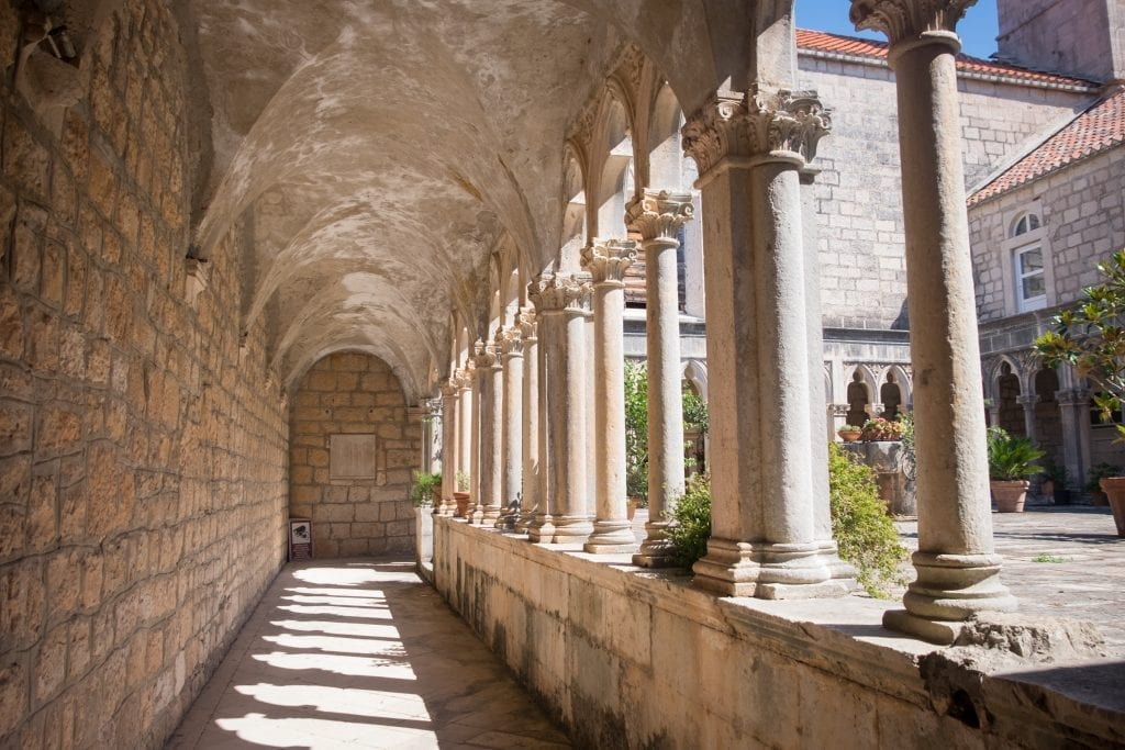 Scene from Badija's monastery -- rows of columns edging a stone courtyard.