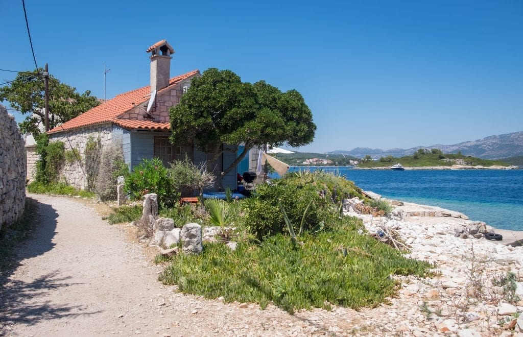 A small cottage on Vrnik island, on the edge of the ocean.
